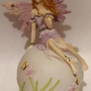 Purple Fairy Sitting on a Ball