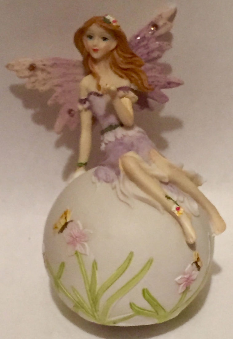 Purple Fairy Sitting on a Ball